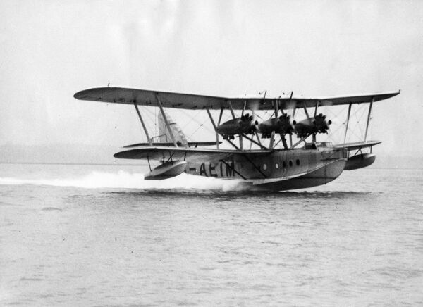 "The short "" Rangoon "" flying boat used as a training machine by Imperial Airways pilots taking off in a practise flight at Hamble"