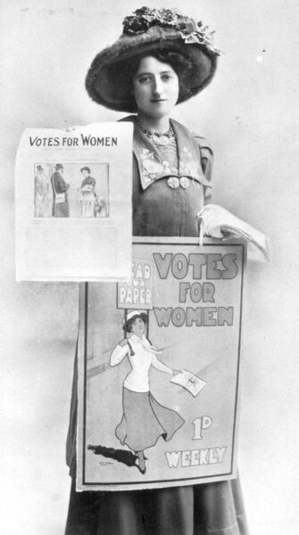 A Suffragette selling Votes for Women posters