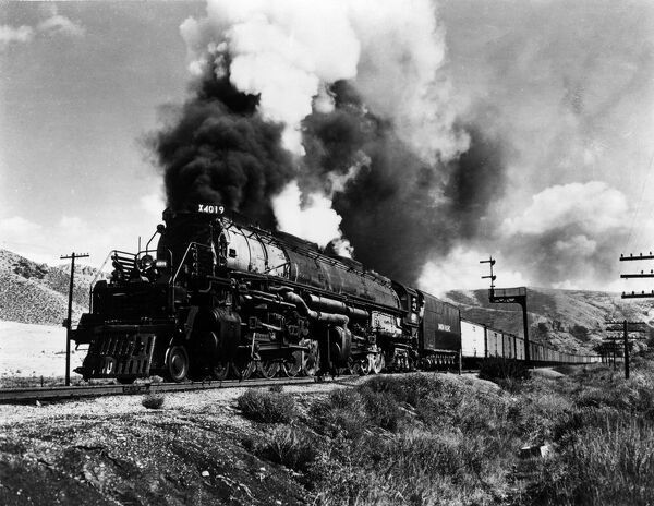 Union Pacific   Class Steam Locomotive   4-8-8-4 Wheel arrangement   Big Boy Class Designation   First of type built in 1941 for freight service. Locomotive and string of PFE cars in Echo Canyon Utah