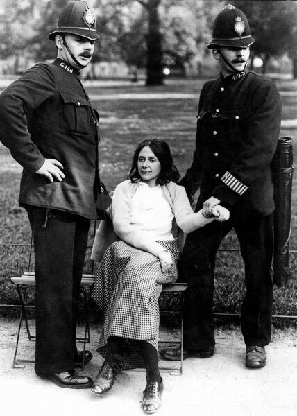 Votes for Women - policeman with a suffragette arrested in Hyde Park in London about 1912 ie early on in the movement. The suffragette herself seems remarkably calm in the face of the two arresting officers, just sitting in a relaxed fashion