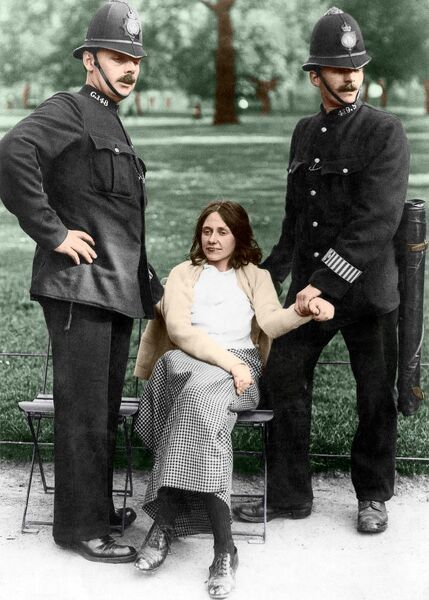 Votes for Women - policemen with a suffragette arrested in Hyde Park about 1912 Colourised photograph