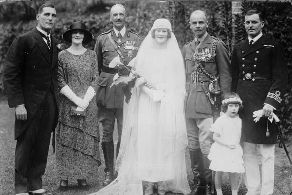 Wedding of distinguished British officer in Hong Kong.  The bridal party after the wedding in Hong Kong of Lt Colonel W N Nicholson and Miss P Higgs. Major General Sir John Fowler, GOC of the China Command, is also seen in the group.  28 April 1924