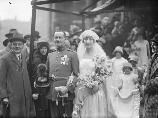 Wedding.  The marriage between Flt Lt Denys Gilley, and Miss K Stocken took place at All Souls Church, Langham Place, W.  Bride and bridegroom.  27 April 1926
