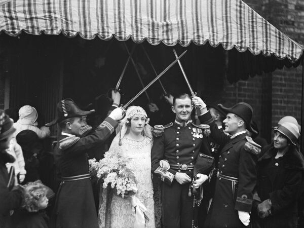 Wedding.  Miss E Badcock and Lt C Maunsell Smyth were married at Holy Trinity.  Bride and Bridegroom.  7 December 1926