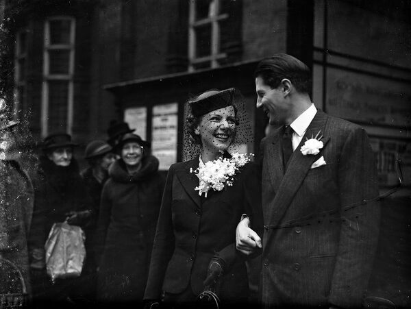 The wedding of Mr Ian Wilson - Young ( second secretary at the Foreign Office ) and Mrs Charlotte Nast at Caxton Hall Register Office, London.  21 February 1940