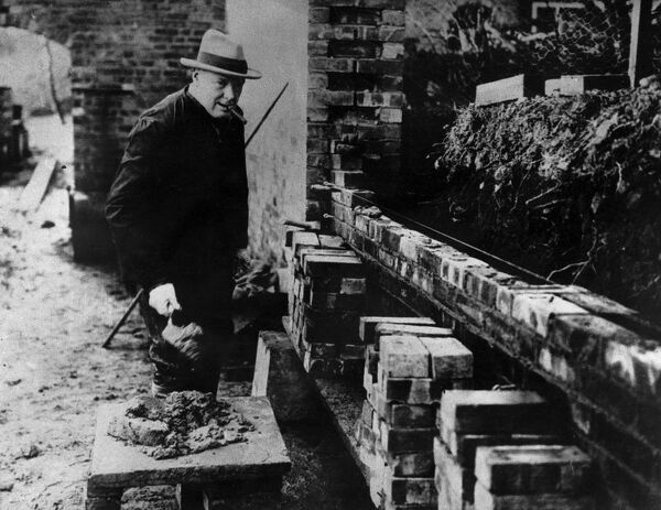 Winston Churchill building a wall at his house Chartwell near Westerham Kent. At