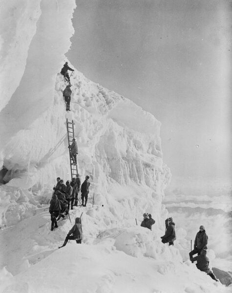 Where winter sports are enjoyed in July.  A remarkable picture of Rainier National Park, Washington, USA showing midsummer visitors ascending a spectacular ice formation near the summit of Mount Rainier.  6 July 1926