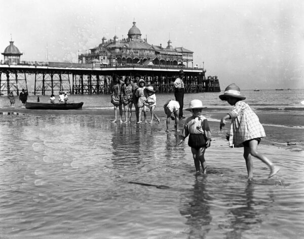 Young children having holiday fun in the sea at Eastbourne. 9 August 1916