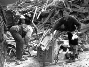11 year old Lambeth boy sells firewood from bombed houses for London's War Weapon Week
