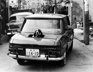 13 NOVEMBER 1964 Only the boot of this Tokyo car is convertible. This lucky pointer