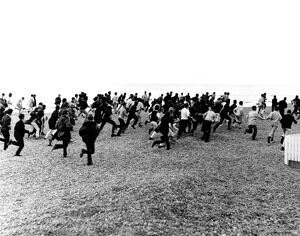 1964. Hastings. Mods and Rockers clash. 3rd August. Racing along the beach