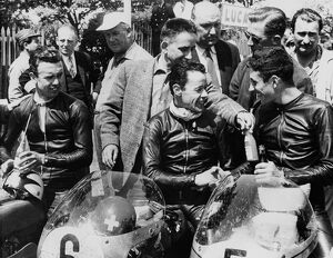 The 1st, 2nd and 3rd seen in the paddock after winning the 125 cc TT race on the Isle of Man
