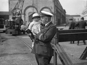 22 month baby Louise Passmore in the arms of Captain Lock on arrival at Southampton