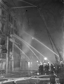250, fireman fight great blaze in West End of London. two hundred and fifty firemen