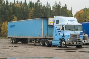 A 6x4 International tracker unit with a 2 axle box reefer (refrigerated trailer)