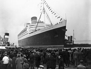 The 83,000 ton Cunard-White Star Liner 'Queen Elizabeth' cast off her moorings