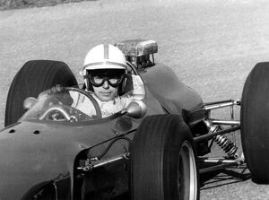After his accident world famous auto racer John Surtees has stepped into a racing