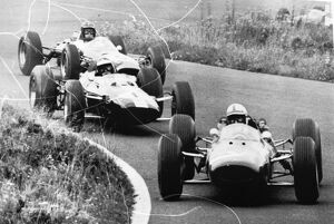 Adenau Germany John Surtees driving a Ferrari leads the pack in the second lap of