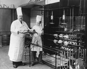 A.H. Cadier, senior chef at the Brighton Pavilion is handed fake chickens by junior