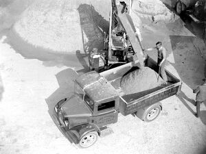 Bedford truck being loaded by a conveyor loader at the Sand & Gravel Co Ltd gray
