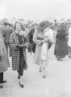 The biggest at Ascot. An outsized hat worn by a women racegoer as she left Waterloo