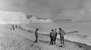 Boys sea fishing at Seven Sisters, Birling Gap, Sussex, England. 1960 ' s