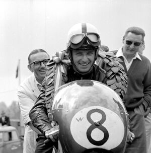 Brands Hatch, Kent: German Motor cycle racing ace, Ernst Degner has a smile of victory
