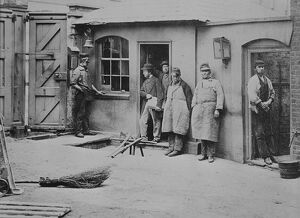 Brewery workers take a break from work for a portrait at the Thames Bank Distillery