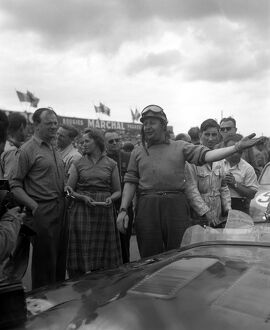 British Driver J Duncan Hamilton smiles and gestures after the victory he and teammate