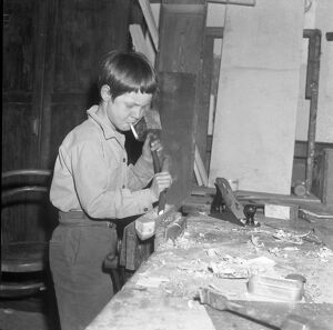 Burgess Hill, Sussex, England : Concentration on carpentry calls for a cigarette