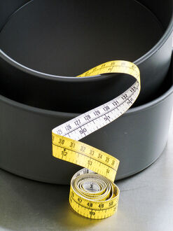Cake tins and tape measure credit: Marie-Louise Avery / thePictureKitchen / TopFoto