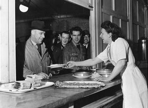 The canteen at the Austin Motor Works where workers queue up to be served. Longbridge