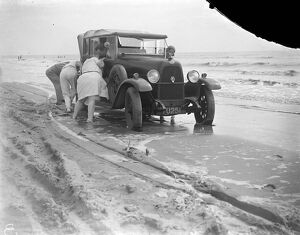 Car stuck on Camber Sands, Sussex. 1933
