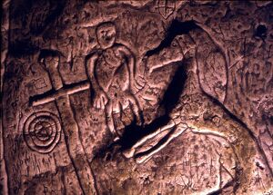 CAVE ART- TEMPLAR CAVE, ROYSTON Bas-relief image of a prancing horse, sword and various