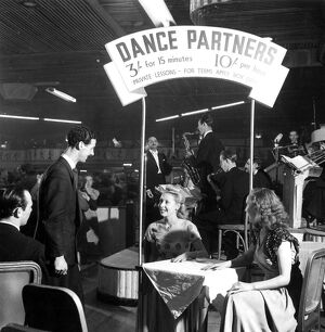 Now it's sixty cents a dance ; Dance hostesses are back again at the Hammersmith