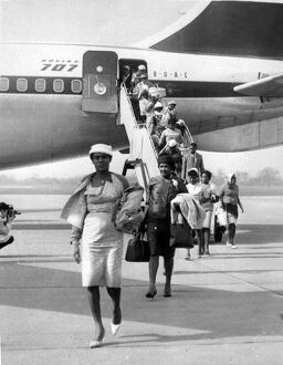 Chartered Boeing 707 jet airliners are flying in hundreds of coloured immigrants