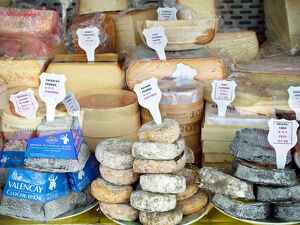 Cheese stall in market in Pas-de-Calais, northern France, selling inter al., Pont