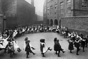 Children in a London council school learn the first steps in dancing. 1908