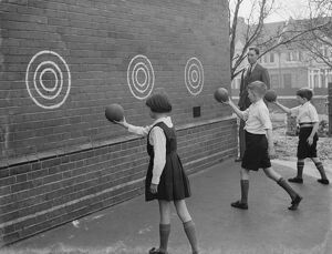 Children play wall ball games at St Mary Cray Council School in Bromley, Kent. 1939