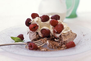 Chocolate meringue with whipped cream and fresh raspberries credit: Marie-Louise