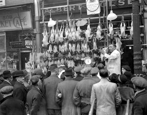 Christmas, 1936. Auctioning the Christmas Turkey. 23 December 1936