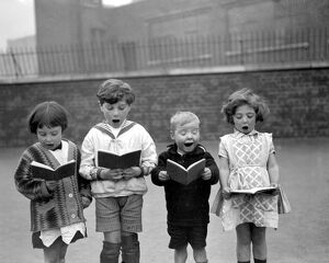 Christmas carols at St Clements Danes School, Drury Lane. 1926