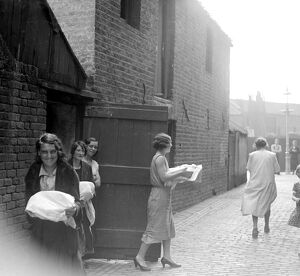 Cooking dinners at the communal ovens in the East End of London. 1933