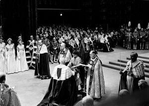 Coronation Day - The Queen receives the spurs in the solemn cermony. The Lord Great