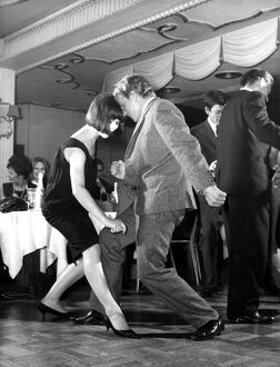 A couple seen dancing Britan's latest dance craze , The Twist , at the Satire Club