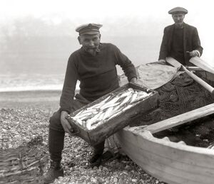 The Coxswain of the Aldeburgh lifeboat , Charlie Mann , with a catch of herrings
