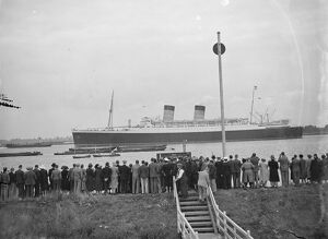 Crowds gather on the bank of the Thames estuary at Long Reach in Dartford, Kent
