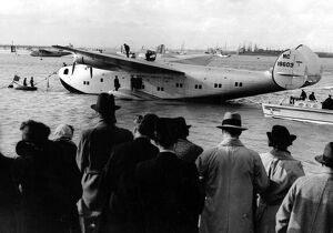 Crowds meet the giant new American flying boat ' Yankee Clipper ' as she