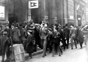Crowds stand outside the White Star Line office in Leadenhall Street, waiting for