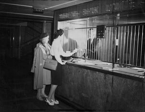 Customers at Midland Bank being attended to by a Bank Teller. 23 October 1946